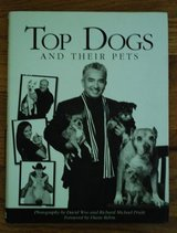"""Top dogs and Their pets""  By David Woo (2009 Hard in Lockport, Illinois"